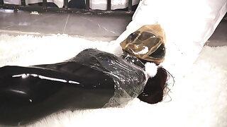 Latex lesbian double tough guy breath play in a sleeping bag
